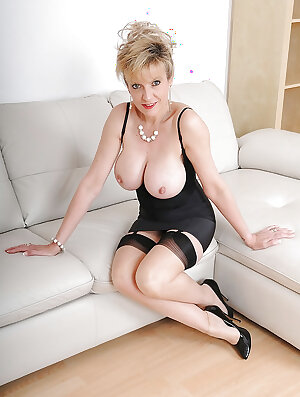 Older fetish minx in lingerie and nylons revealing her big breasts