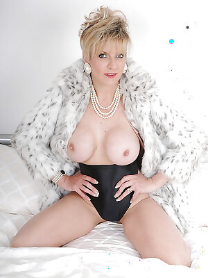 Busted older fetish lady posing in fur and black girdle