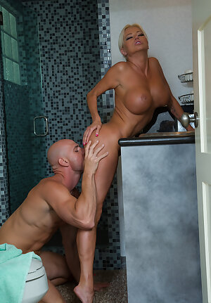 Skinny Russian cougar Nikita Von James with fake titsgives a raunchy blows and fucks in the bathroom