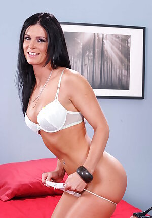 Slender MILF porn star India Summer stripping to her white lingerie and posing for you