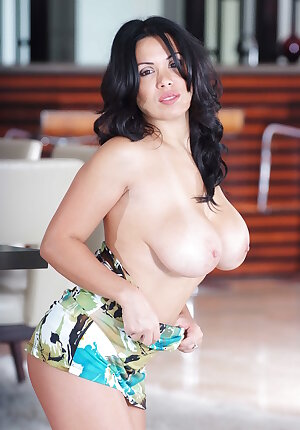 Chubby mature woman Sienna West exposes her large tits as she undresses