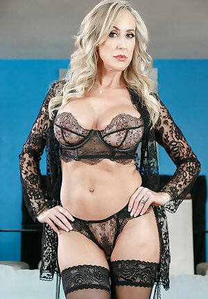 Glamorous lady Brandi Love getting rid of her black exotic lace lingerie