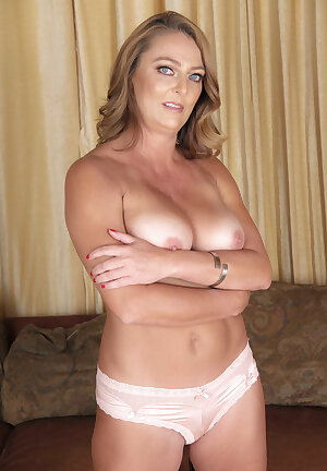 Solo mature Brenda James reveals her older breasts and pussy