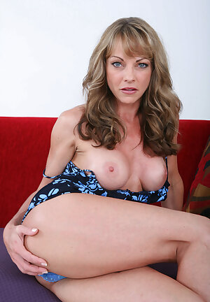 Tall older woman Shayla LaVeaux slips off her dress to pose nude