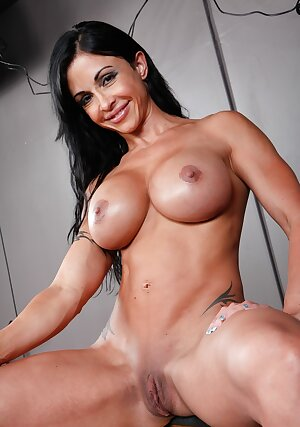 Sensual MILF Jewels Jade reveals her perfect breasts and ass in a solo