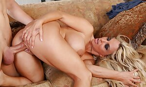 Insatiable busty cougar Holly Halston pleases and fucks a young hard dick