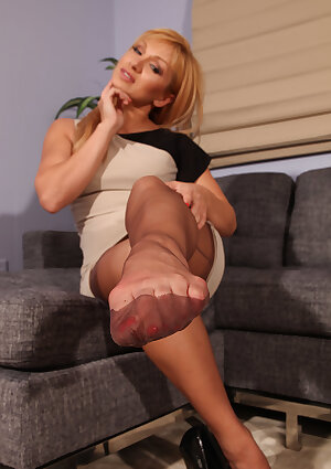 Blonde female Lea Lexis spreads her nylon ensconced legs