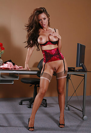 Nerdy office babe Crissy Moran takes off her glasses and skirt before a finger fuck in nylons