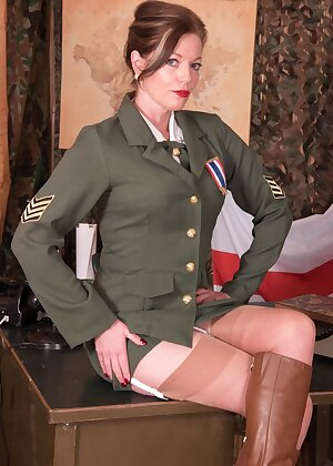 British military lady Holly Kiss strips