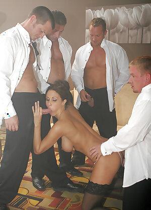 Busty MILF Julia Ann gagging on big cocks in a wild gangbang