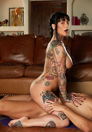 Heavily tattooed slut Jessie Lee blowing and riding cock cowgirl style