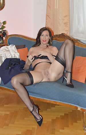 British MILF Lara posing in nylons and high heels