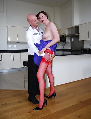 With nothing but some bright red stockings UK housewife gets fucked in kitchen