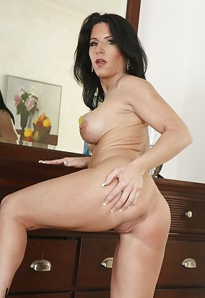 Naked mature Kendra Secrets on high heels showcasing her tight body