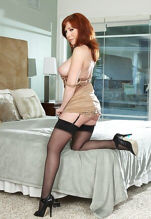 Stunning redhead lady Brittany O\'Connell in stockings