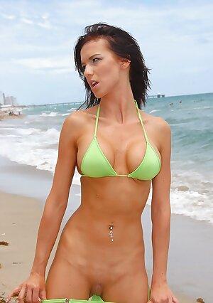 Big boob MILF in bikini on public beach