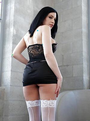 Dark haired MILF Cassandra Cain reveals nice ass in white stockings