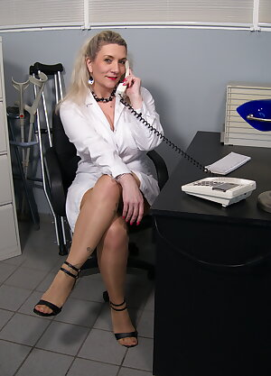 Big breasted mature doctor