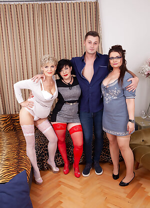 Three very horny mature sluts share one hard young lad in their groupsex