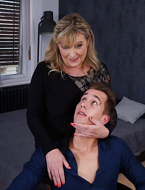 Busty lady next door gets a visit from her young neighbour