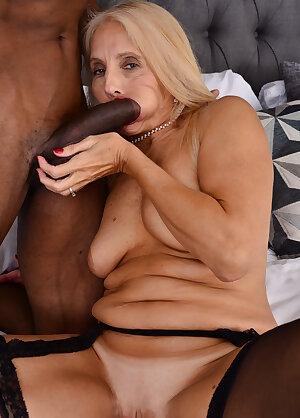 Mature slut loving a big black hard cock up her ass