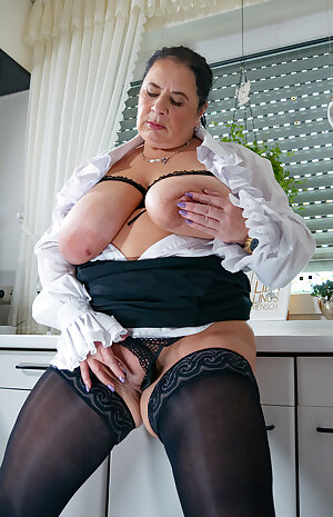 Huge breasted mature Maid playing in the kitchen