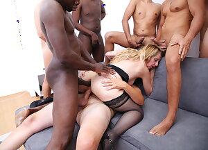 Naughty mature slut gets all holes filled in this gang bang