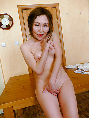 Penite Asian mature lady fucking and sucking a hard cock