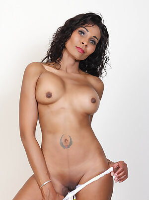 Beautiful black MILF playing with her shaved pussy