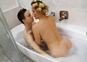 Hot MILF catches a young guy taking a bath and decides to join him