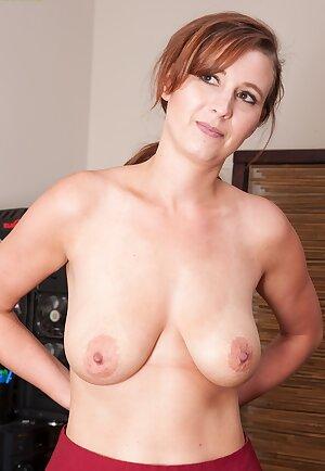Busty secretary Alice Chambers spreads her meaty pussy lips