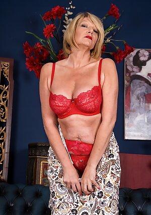 Busty mature Amy Goodhead spreading her pierced pussy
