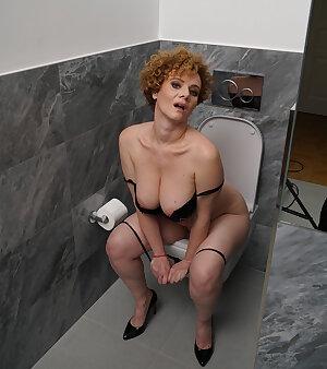 Busty mama playing in the bathtub