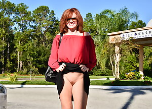 Horny MILF showing off her pussy in public