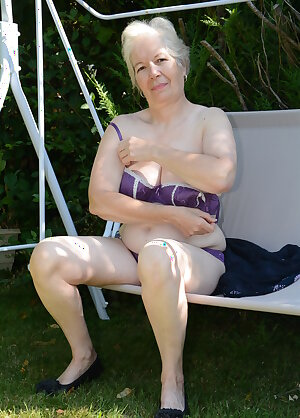 Horny British granny playing in the garden