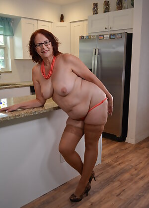 American granny playing in the kitchen