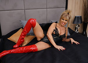 Fetish British MILF in red boots playing with her younger lover