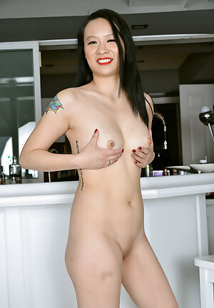 Asian wife Zoe Lark posing in sheer black dress