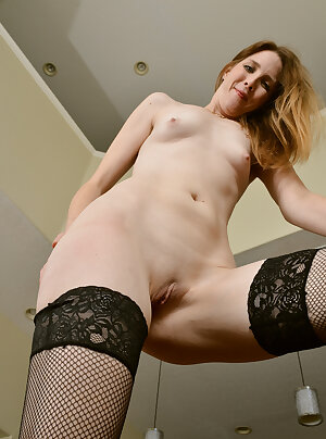 Sexy thigh highs wife Isabella Jane posing in black fishnet stockings
