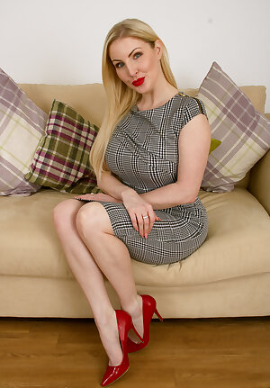 Sweet blonde model Georgie Lyall  on the couch
