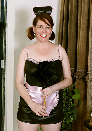 Curvy redhead mature maid Caitlin Moore