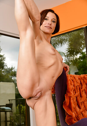 Slim and short haired redhead mom Stella Banks