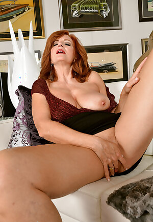 Voluptuous redhead lady Andi James fingering her old pussy