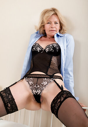 Older housewife poses in lingerie