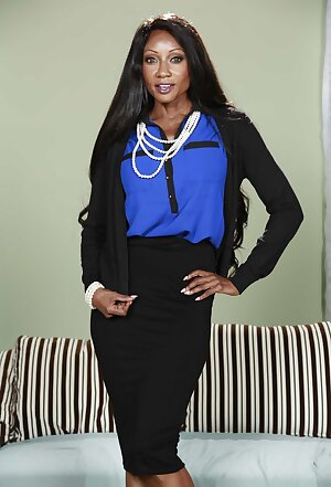 Black business woman Diamond Jackson undresses after work day is over