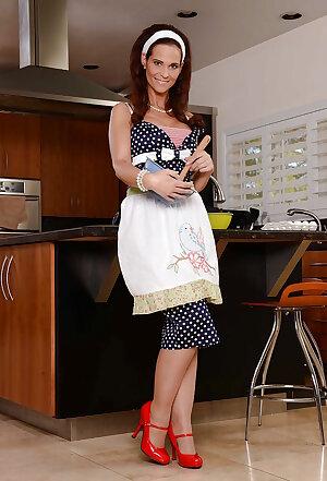 Mature housewife Syren De Mer posing in kitchen