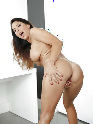 Busty pornstar Lezley Zen fingering in high heels