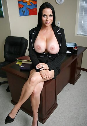 Hot business woman Harley Rain takes out her huge tits in the office