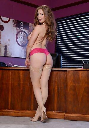 Voluptuous executive Lauren Phillips squats naked on her desk