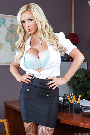 Sizzling secretary Nikki Benz sheds her suit to pose in